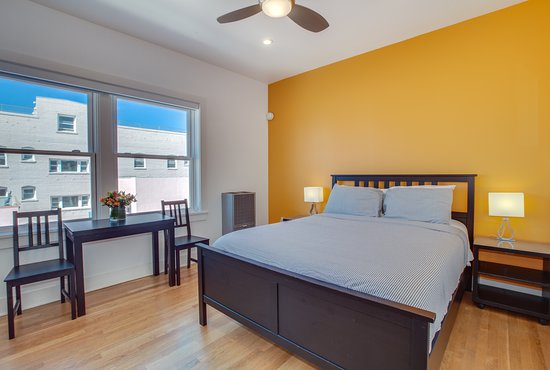 Superb Guestroom With Yellow Accent Wall Picture Of Venice Suites Home Interior And Landscaping Ferensignezvosmurscom