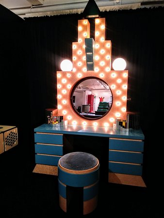deco style vanity with mirror and seat