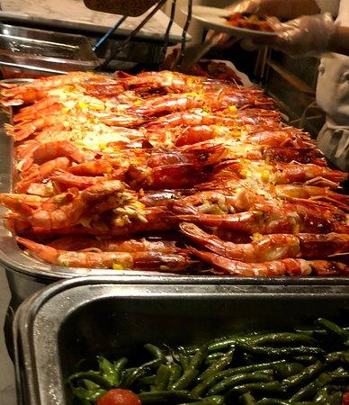 Roasted whole shrimp on the buffet
