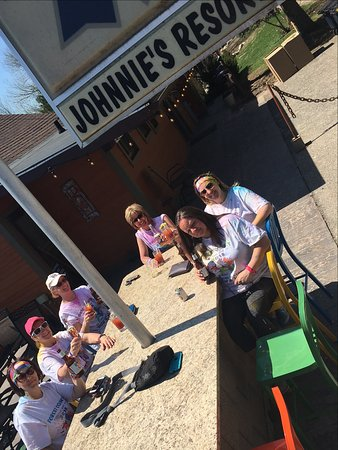 Laona, WI: Relaxing on the veranda after the Color Run for the Forest County Ties That Bind Us fundraiser in Crandon.