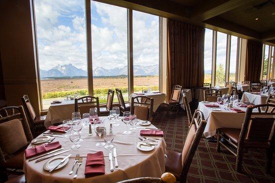 Every table has a panoramic view of the Teton Range and Jackson Lake.