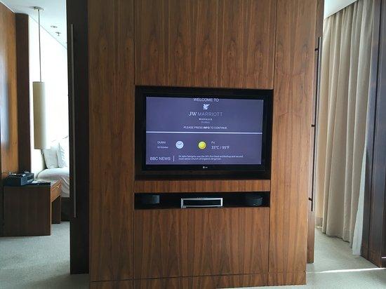 JW Marriott Marquis Hotel Dubai: Looking towards bedroom, with barn door style doors to close off living room from bedroom or our suite