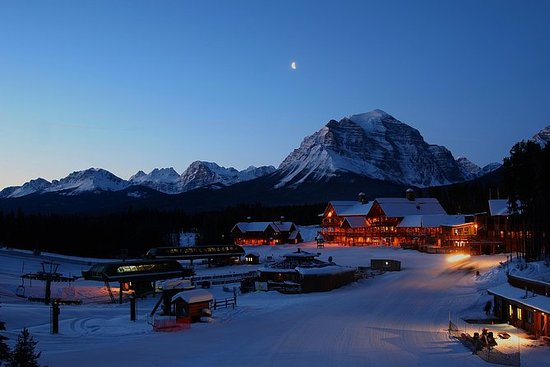 Excursão de raquetes de neve à noite...