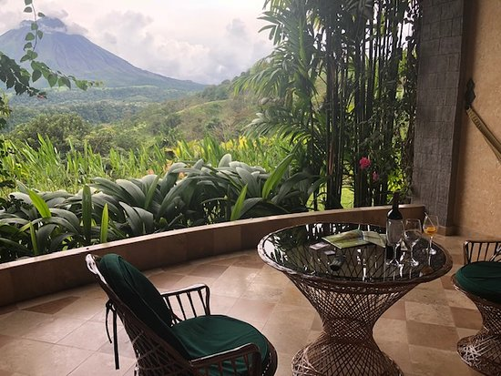 Luxurious hotel with hot springs and views of the jungle and volcano