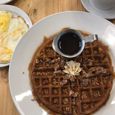 A fabulous go to Sunday Brunch place!  Buy a Leader newspaper, buy coffee, sweets, candles, gifts from their shelves. The BEST pumpkin waffle, mocha and bottomless mimosa. Enjoy this gem. Great service with Deeana!