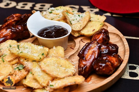 Texas BBQ: Texas Wings served with parmesan cihps and sauce
