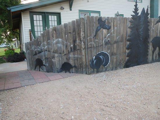 Taylor, NE: Art work on the fence next to the Inn.