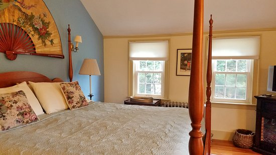Northfield, MA: California king four-poster bed with view of the property.