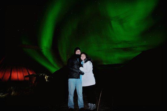 See the northern lights after an evening of reindeer sledding