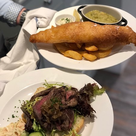 Haddock fillet dipped in our crispy beer batter served simply with triple cooked chips, tartare sauce and mushy peas and warm sirloin steak open sandwich with sticky red onion marmalade