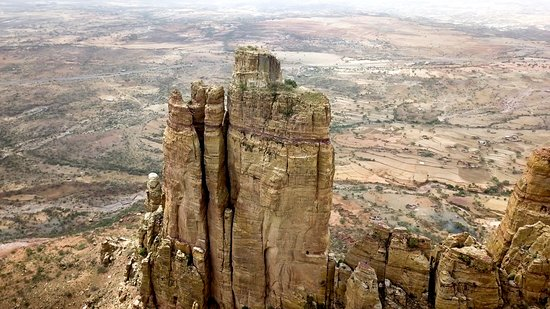 Hawzen, Etiopia: To reach Ethiopia's Abuna Yemata Guh, you must first climb a 650-foot vertical cliff face. But once you get to the top, the views are breathtaking.