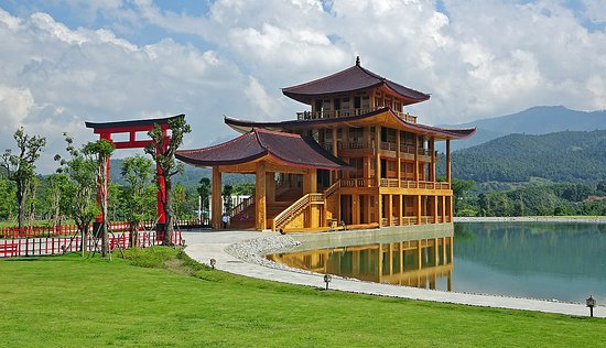 Chai Prakan, Thailand: View of the lake and Japan building from the walkway.