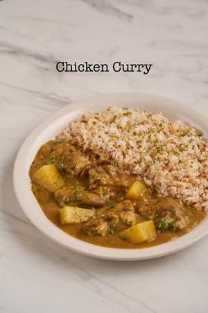Grilled Chicken Curry - marinated and grilled chicken in a yellow curry sauce.