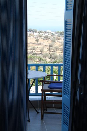 Hotel Anthousa: view through shuttered doors to balcony and beyond - in the heart of sifnos