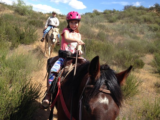 Kids age 4 to 7 will ride a horse lead by a guide. Usually by age 8 a child can handle one of our gentle horses.