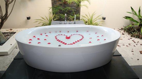 Bathtub in room bathroom
