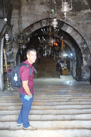 Descending the stairs at the entrance to Church of the Sepulchre of Saint Mary (Tomb of Virgin Mary) on the Mt of Olives.