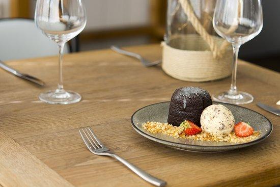 CHOCOLATE FONDANT  Dark chocolate fondant with a butterscotch centre served with homemade Toblerone ice cream and hazelnut praline