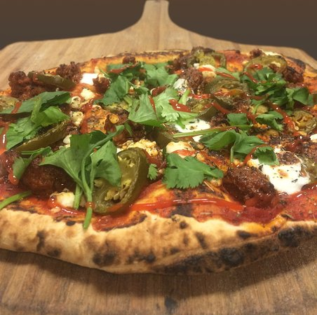 Wapato, WA: One of our Local Loco pizzas -- periodic pizzas based on local availability of fresh ingredients or something special. Chorizo, goat cheese and cilanto are the heros on this pie!