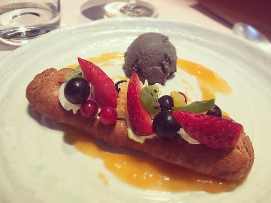 Bye Bye Blues: Eclair filled with pistachio cream served with sesame ice cream