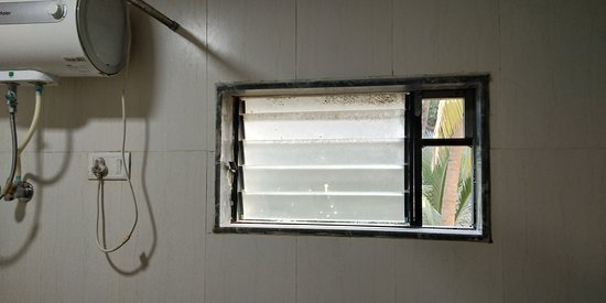 Missing Glass On The Right Side Of The Bathroom Window Picture Of Hotel Sea Rock Villa Daman Tripadvisor