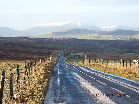 Harray, UK: The Hobbister road, Snow capped Hoy hills