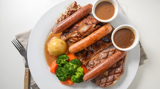 The Triple Combo. A steak, lamb chop, chicken chop and 3 gourmet sausages, served with a selection of our homemade sauces. Choose this if you can't decide what to eat.