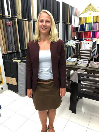 A happy young lady in her new tailored jacket at King's Fashion