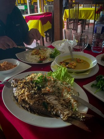 Serendib Restaurant: Grilled whole Grey Mullet (local name), Sri Lankan rice, coconut symbol and prawn curry and rice.