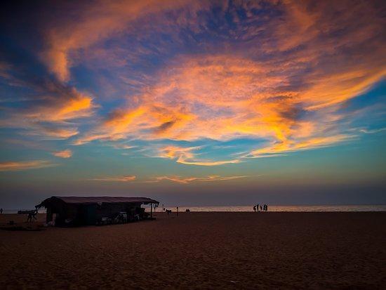 Sunset over fisherman's hut outside Serendib Restaurant, Negombo Beach.