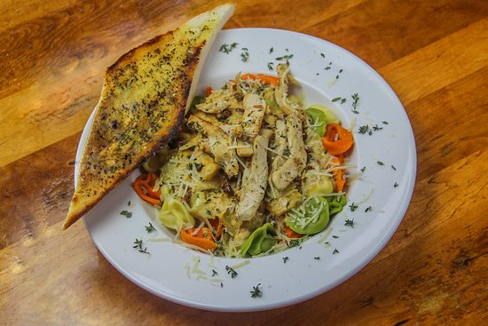 Rothbury, MI: Cajun Chicken Tortellini: Grilled chicken breast, house-made Cajun alfredo sauce served on a bed of cheese-stuffed tortellini, artichoke and sundried tomatoes, with rustic bread.