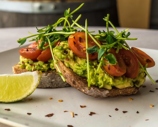 Seed n Salt: Avo toast - multigrain sourdough, smashed avocado, local tomatoes, local pea shoots, lime and chillies