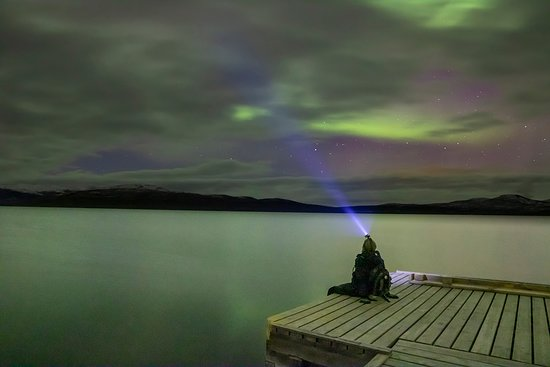 The northern lights above the Torneträsk lake