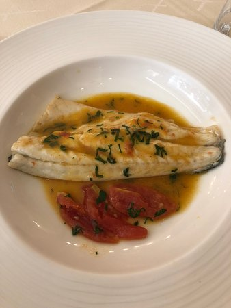 "Sea Bass in ""Crazy Water."" This was prepared in our cooking classes."