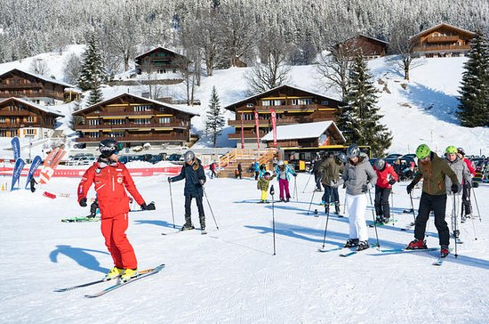 Lezione di sci o snowboard per
