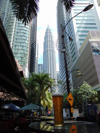 Contemplating the Petronas towers from the patio with a cold beer!
