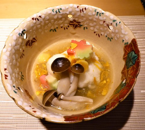 Tilefish with mushrooms, grated turnip, gingko nut, and chrysanthemum (shungiku) sauce