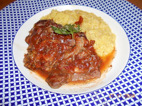 Veal Ossobucco (tender meat on the bone with saffron risotto