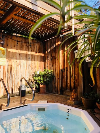 One of our beautiful private outdoor hot tubs.