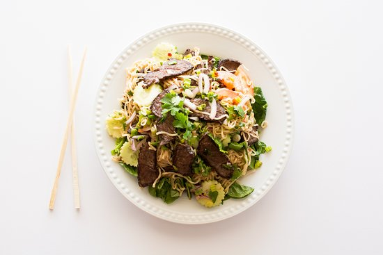 Thai Street Market: Thai Steak & Noodle Salad: Steak mixed with leafy greens and noodles and topped with our homemade Thai chili dressing.