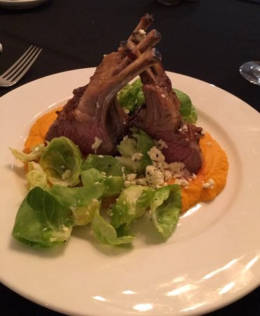 "One of our dinner options ""Rack of Lamb with carrot puree"" and seasonal greens."