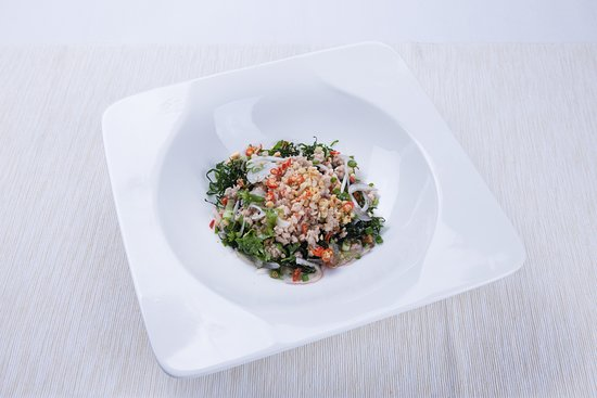 Crunchy kale salad with prawns and pork in Thai-style sour and spicy dressing