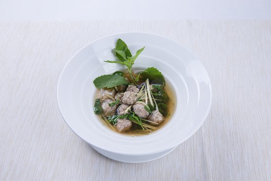 Clear soup with minced pork, holy basil and ginger
