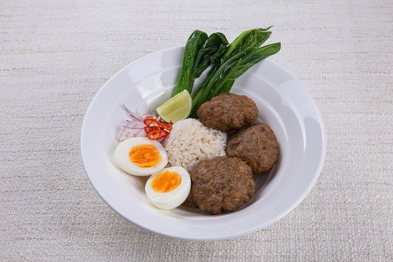 Pork balls, salted fish, shallots and chili on rice topped with a soft-boiled egg