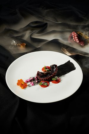 Confit Octopus served with Salted Eggs Sauce and Black Garlic