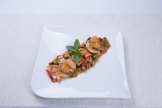 Panang red curry with kaffir leaves,Thai eggplant and chicken or pork