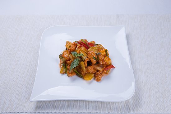 Sweet and sour chicken with bell peppers and pineapple
