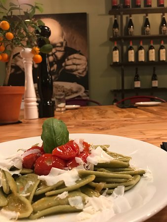 spinach pasta from puglia with cherry tomatoes and cacioricotta cheese