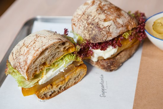 vegetarian sandwich with golden beetroot and camembert