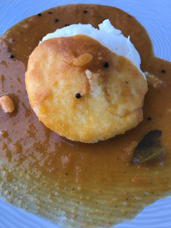 Idly is a type of savory rice cake, served with dal (lentils)
